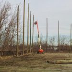 Wood support pole installation
