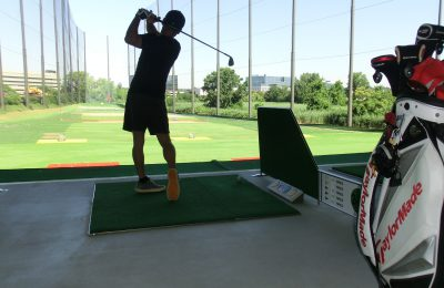 Golfer Practicing at 21Golf Netted Driving Range