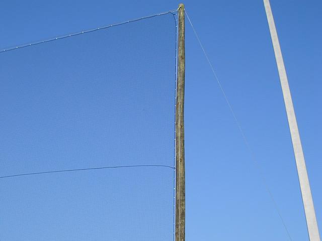 Baseball Netting On Wood Poles. Retractable Sports Netting