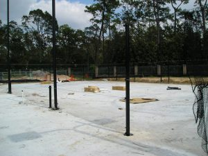 Setting support poles for tennis netting