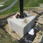 Steel Pole Installation onto concrete footer slab