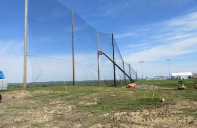 Installing golf netting panels for driving range