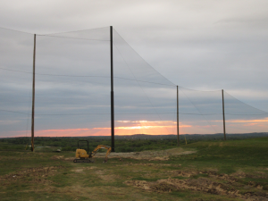 Completed view of golf netting installation