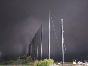 Fog rolling in at the end of the day installing Golf Netting Panels