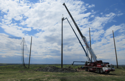 Steel support pole installation for driving range