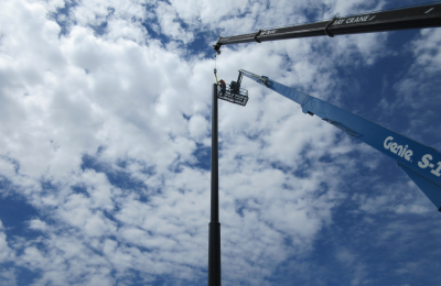 Completing the steel pole installation for the driving range